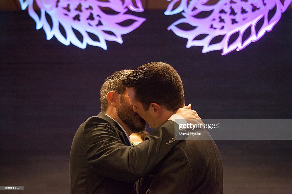 Steven Austin and Michael Pirkle kiss during their wedding at City Hall on December 9, 2012 in Seattle, Washington. Today is the first day that same-sex couples can legally wed in Washington state.