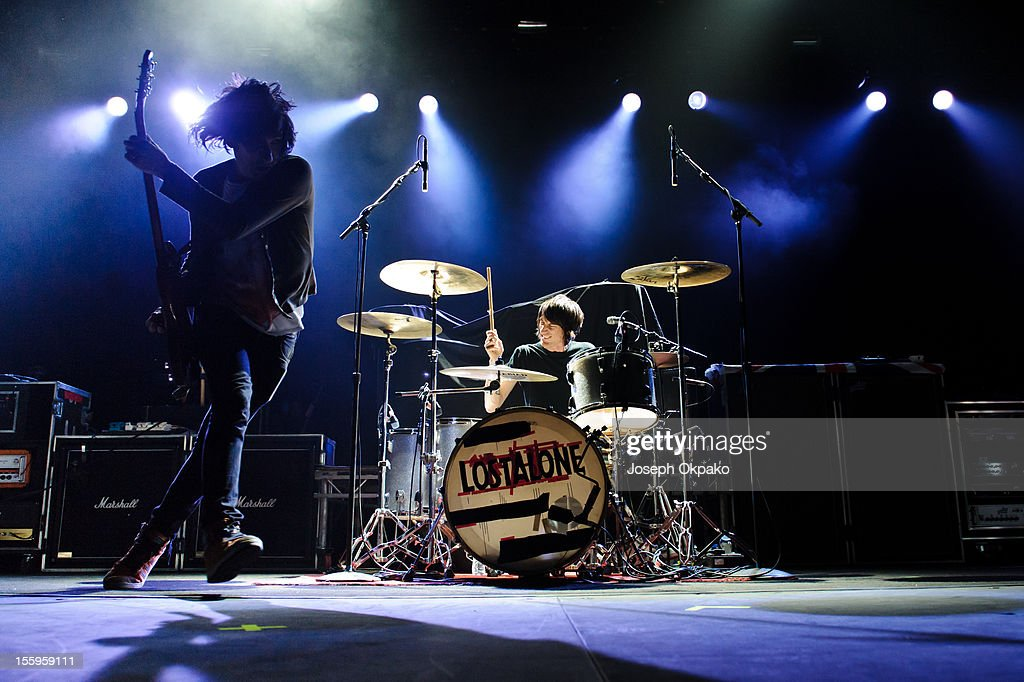 Steven Battelle and Mark Gibson of the band Lost Alone performs on stage at Wembley Arena on November 9, 2012 in London, United Kingdom.