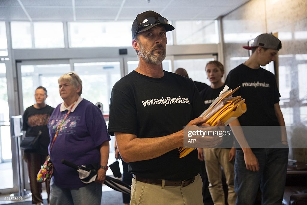 Steven Been brotherinlaw of Jeff Wood prepares to deliver a petition with over 10000 signatures to the office of Governor Greg Abbott on August 18...