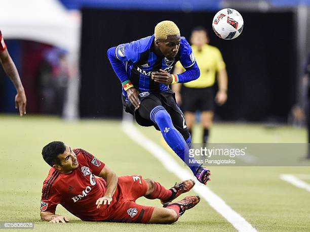 Steven Beitashour of the Toronto FC challenges Ambroise Oyongo of the Montreal Impact during leg one of the MLS Eastern Conference finals at Olympic...
