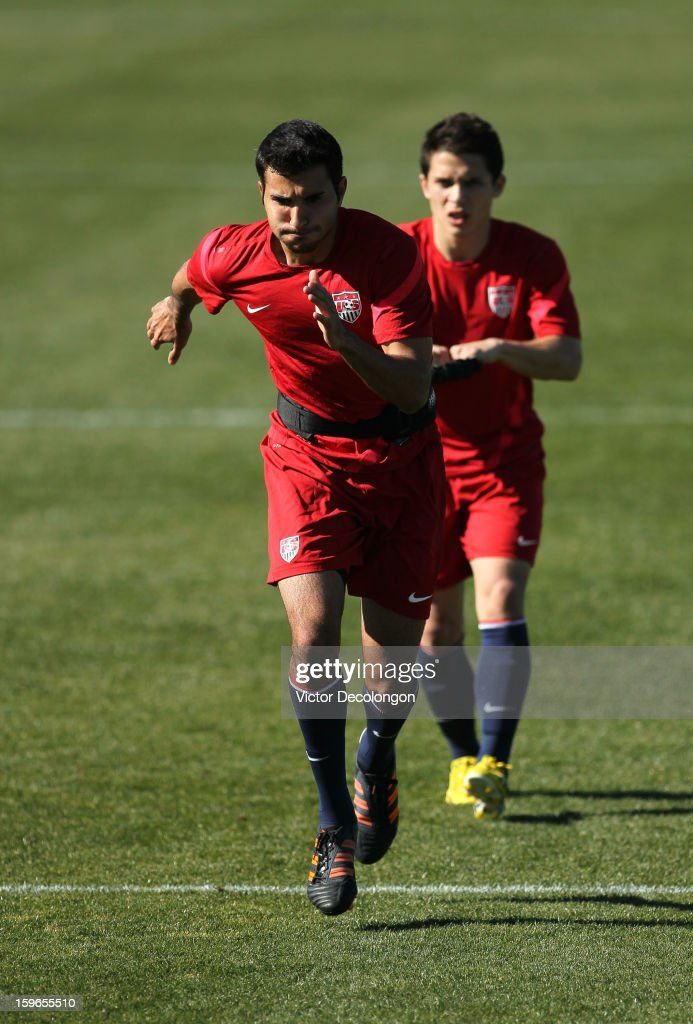 Steven Beitashour works on his sprint and acceleration with teammate Connor Lade during U.S. Men's Soccer Team training session at the Home Depot Center on January 17, 2013 in Carson, California.