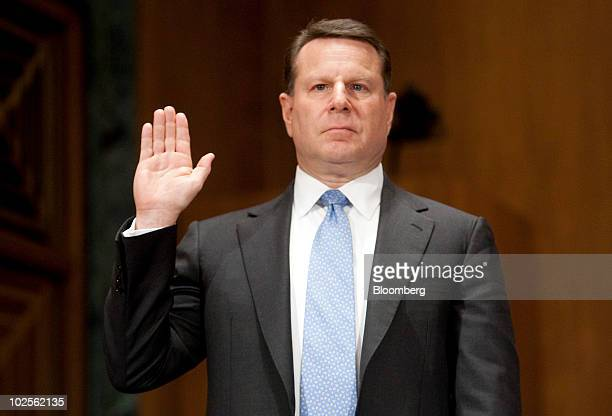 Steven Bensinger former executive vice president and chief financial officer of American International Group Inc swears in during a Financial Crisis...