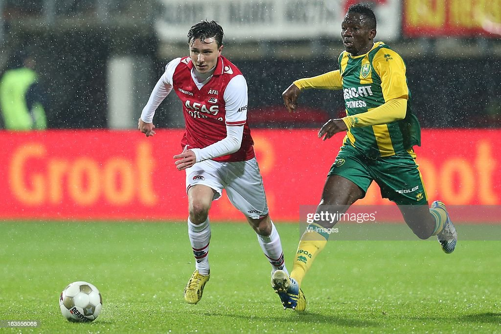 Steven Berghuis of AZ , Kenneth Omeruo of ADO Den Haag during the Dutch Eredivisie match between AZ Alkmaar and ADO Den Haag at the AFAS Stadium on march 09, 2013 in Alkmaar, The Netherlands