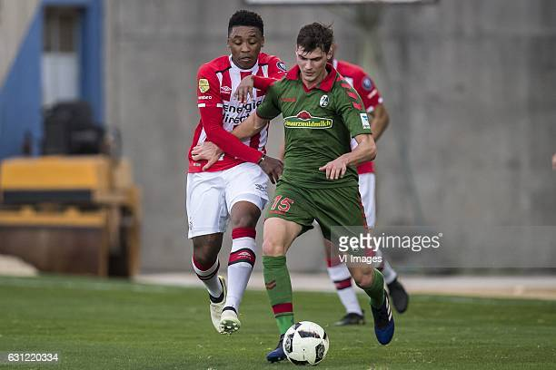 Steven Bergwijn of PSV Pascal Stenzel of SC Freiburgduring the friendly match between PSV Eindhoven and SC Freiburg at the stadium Nuevo Mirador on...