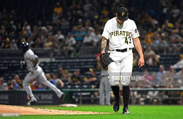 Steven Brault of the Pittsburgh Pirates reacts as Domingo Santana of the Milwaukee Brewers rounds the bases after hitting a solo home run in the...