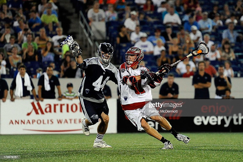Steven Brooks #44 of Chesapeake Bayhawks battles for the ball against Mike Stone #41 of Boston Cannons during a game at Navy-Marine Corps Memorial Stadium on July 18, 2013 in Annapolis, Maryland.