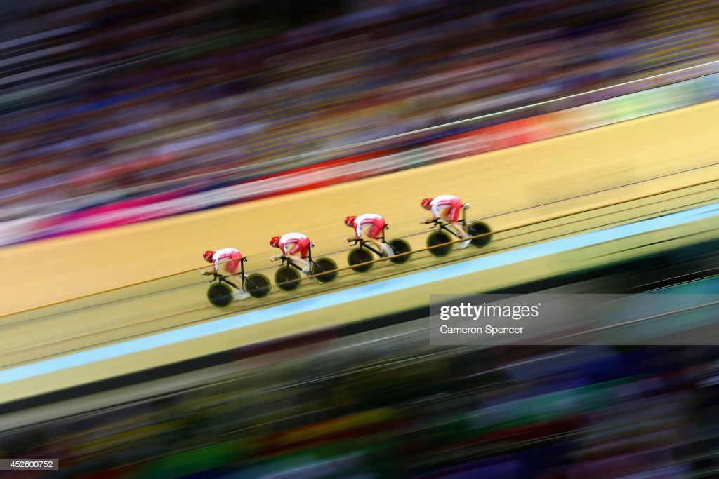 Steven Burke, Ed Clancy, Andy Tennant and Bradley Wiggins of England compete in Men's 4000 metres Team Pursuit qualification at Sir Chris Hoy Velodrome during day one of the Glasgow 2014 Commonwealth Games on July 24, 2014 in Glasgow, Scotland.