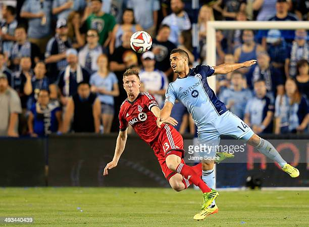 Steven Caldwell of Toronto FC and Dom Dwyer of Sporting KC dive for the ball during the game at Sporting Park on May 23 2014 in Kansas City Kansas