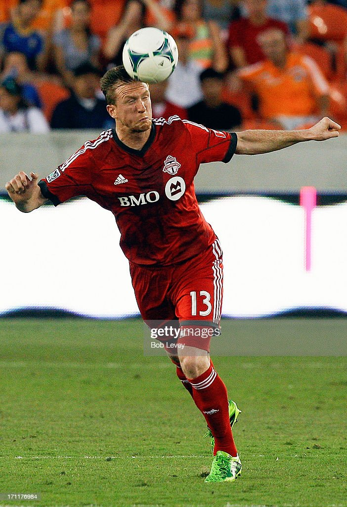 Steven Caldwell #13 of Toronto FC clears the ball away in the second half against the Houston Dynamo at BBVA Compass Stadium on June 22, 2013 in Houston, Texas.