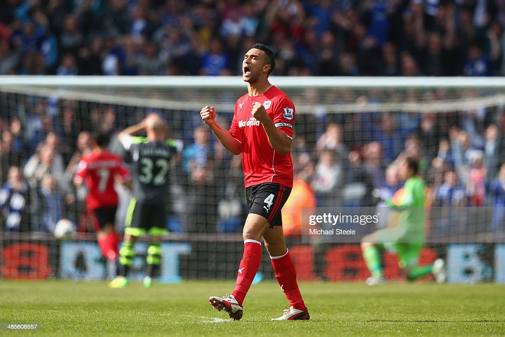 <a gi-track='captionPersonalityLinkClicked' href=/galleries/search?phrase=Steven+Caulker&family=editorial&specificpeople=6527106 ng-click='$event.stopPropagation()'>Steven Caulker</a> of Cardiff City celebrates the equalising goal during the Barclays Premier League match between Cardiff City and Stoke City at the Cardiff City Stadium on April 19, 2014 in Cardiff, Wales.