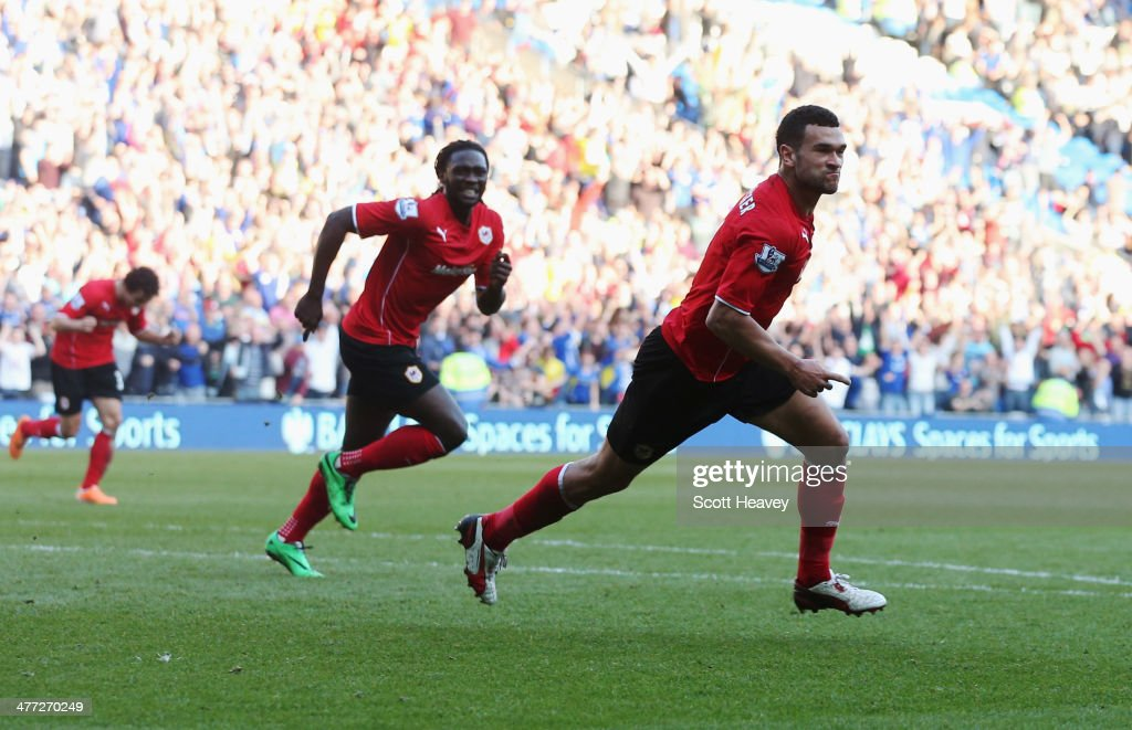 <a gi-track='captionPersonalityLinkClicked' href=/galleries/search?phrase=Steven+Caulker+-+Soccer+Player&family=editorial&specificpeople=6527106 ng-click='$event.stopPropagation()'>Steven Caulker</a> of Cardiff City (R) celebrates with <a gi-track='captionPersonalityLinkClicked' href=/galleries/search?phrase=Kenwyne+Jones&family=editorial&specificpeople=553966 ng-click='$event.stopPropagation()'>Kenwyne Jones</a> as he scores their second goal during the Barclays Premier League match between Cardiff City and Fulham at Cardiff City Stadium on March 8, 2014 in Cardiff, Wales.