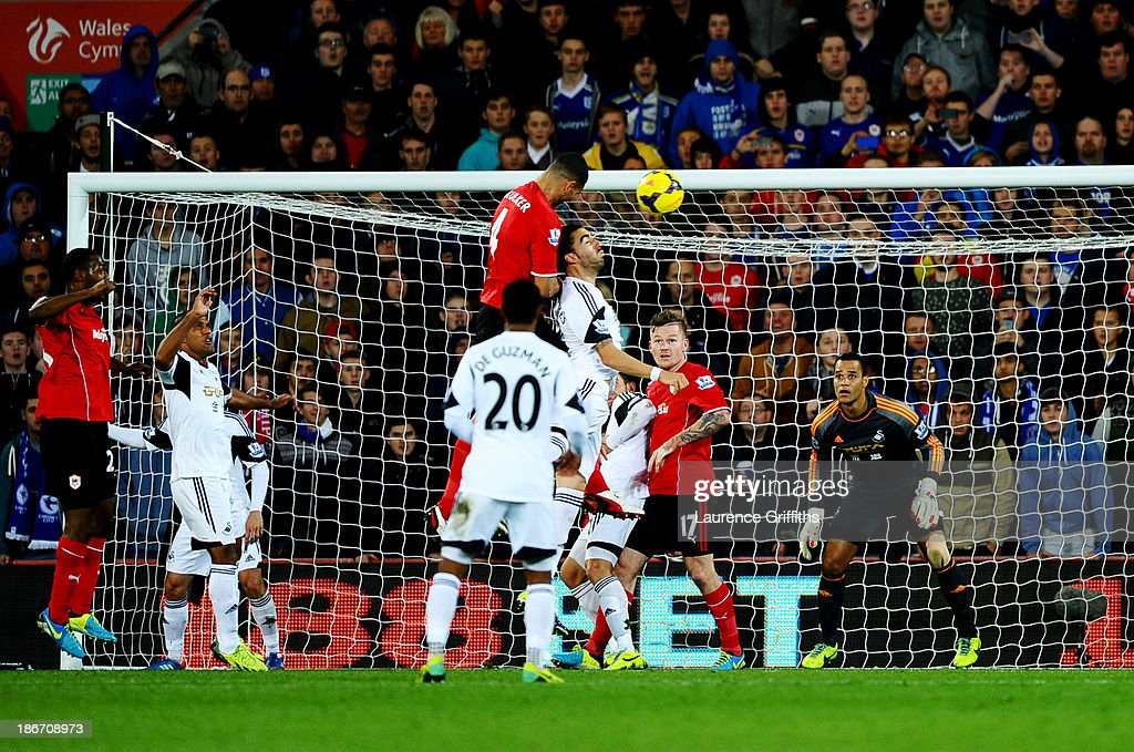 Steven Caulker of Cardiff City rises highest to score their first goal with a header during the Barclays Premier League match between Cardiff City...