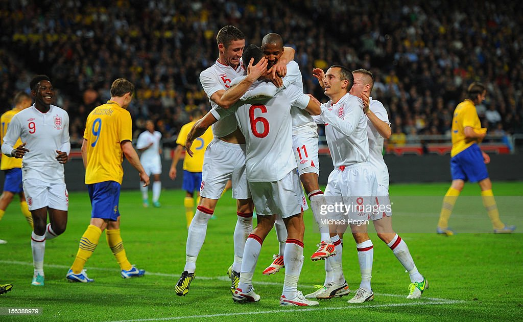 <a gi-track='captionPersonalityLinkClicked' href=/galleries/search?phrase=Steven+Caulker+-+Soccer+Player&family=editorial&specificpeople=6527106 ng-click='$event.stopPropagation()'>Steven Caulker</a> of England celebrates scoring to make it 2-1 with team mates during the international friendly match between Sweden and England at the Friends Arena on November 14, 2012 in Stockholm, Sweden.