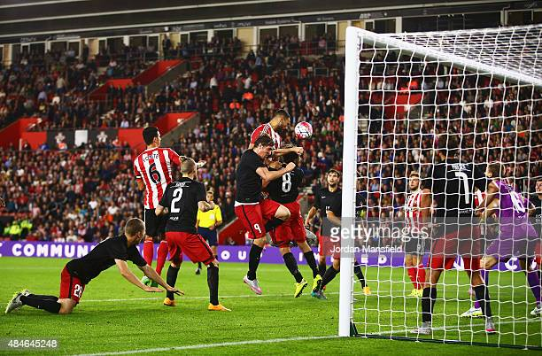 Steven Caulker of Southampton heads towards goal during the UEFA Europa League Play Off Round 1st Leg match between Southampton and Midtjylland at St...