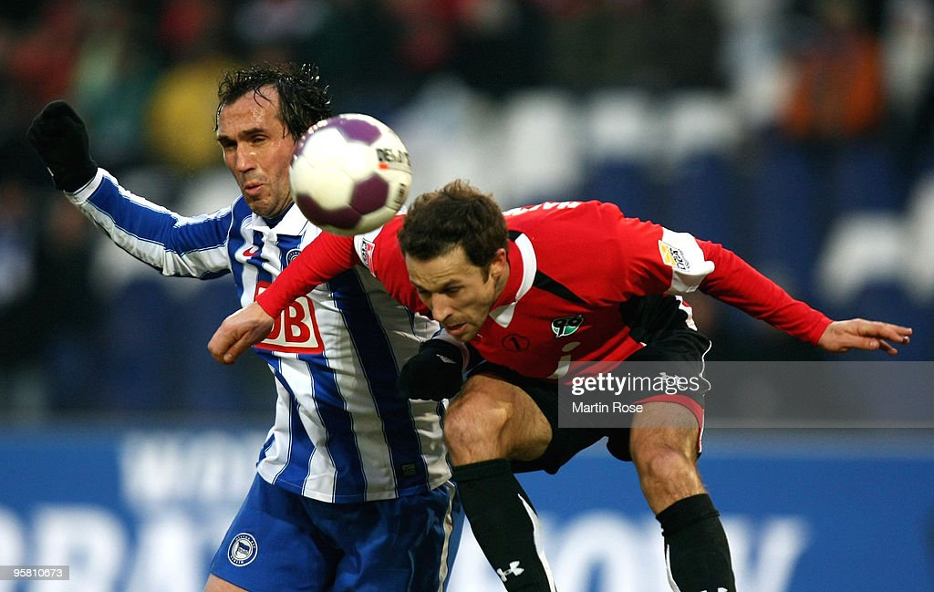 Steven Cherundolo of Hannover 96 and Theofanis Gekas of Berlin compete for the ball during the Bundesliga match between Hannover 96 and Hertha BSC...