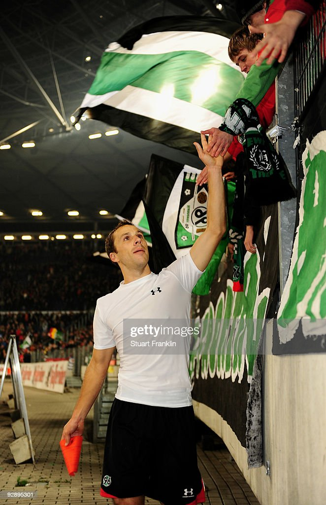 Steven Cherundolo of Hannover 96 celebrates with fans at the end of the Bundesliga match between Hannover 96 and Hamburger SV at AWDArena on November...