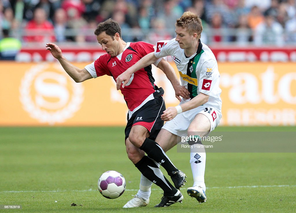 Steven Cherundolo of Hannover battles for the ball with Marco Reus of Moenchengladbach during the Bundesliga match between Hannover 96 and Borussia...