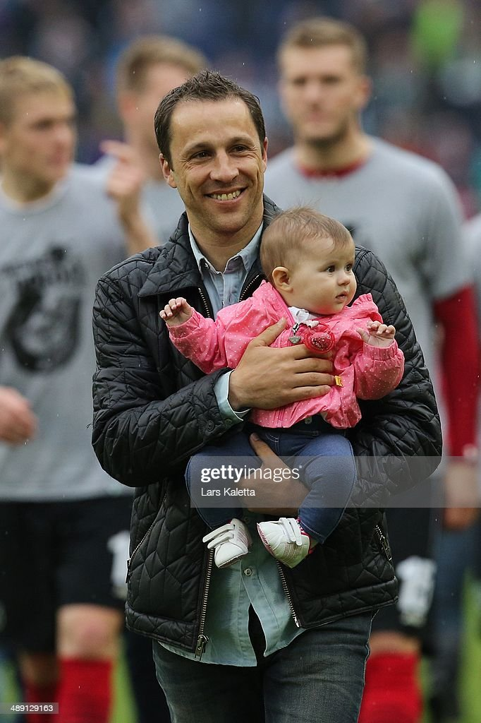 Steven Cherundolo of Hannover smiles after the Bundesliga match between Hannover 96 and SC Freiburg at HDIArena on May 10 2014 in Hanover Germany