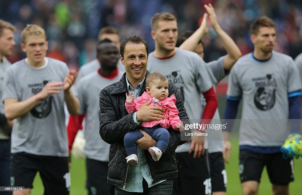 Steven Cherundolo of Hanover smiles after the Bundesliga match between Hannover 96 and SC Freiburg at HDIArena on May 10 2014 in Hanover Germany