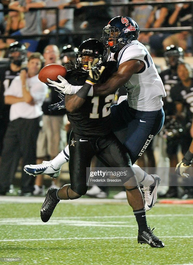 Steven Clarke #12 of the Vanderbilt Commodores defends a pass to Laquon Treadwell #1 of the Ole Miss Rebels at Vanderbilt Stadium on August 29, 2013 in Nashville, Tennessee.