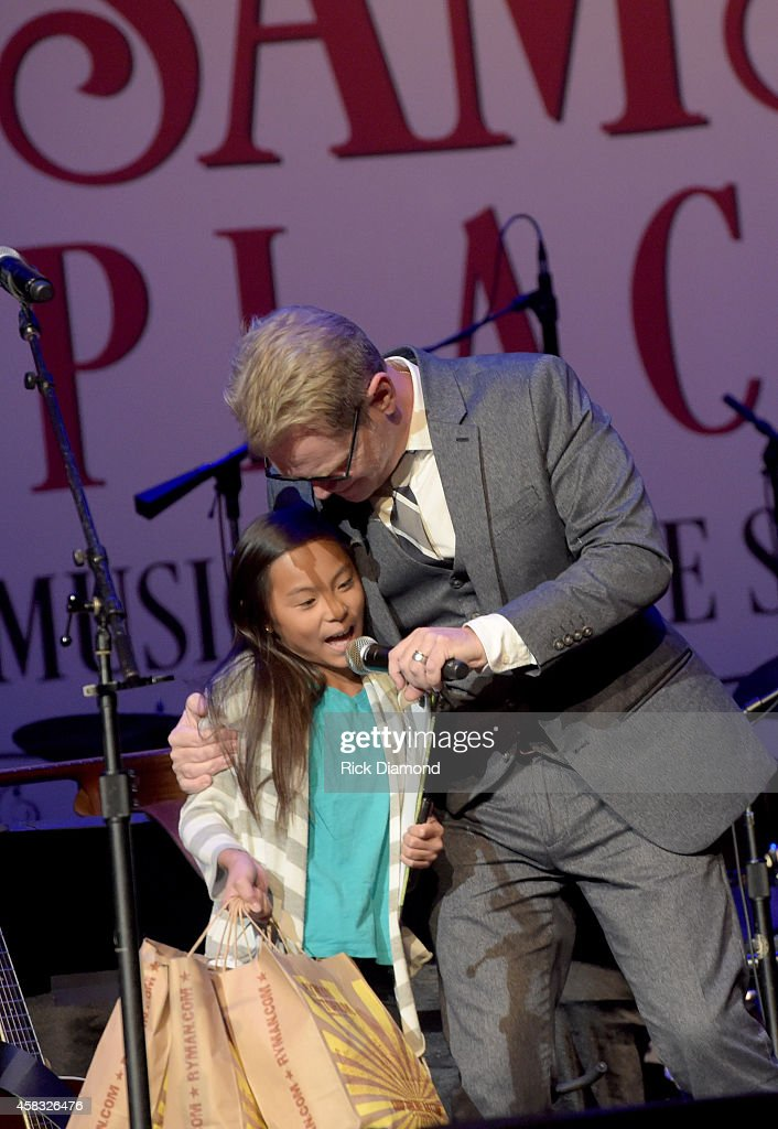 Steven Curtis Chapman and Daughter during Hope Adoption Aid Grant presentation as part of the first of six monthly concerts hosted by Steven Curtis Chapman, Sam's Place - Music For The Spirit at Ryman Auditorium on November 2, 2014 in Nashville, Tennessee.