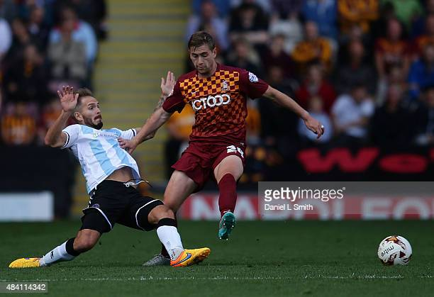 Steven Davies of Bradford attacks Martin Woods of Shrewsbury Town FC during the League One match between Bradford City AFC and Shrewsbury Town FC at...