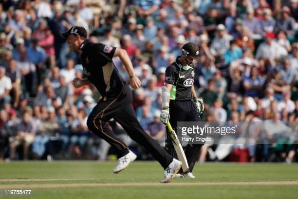 Steven Davies of Surrey walks off after being caught by Rikki Clarke of Warwickshire during the Clydesdale Bank 40 match between Surrey and...