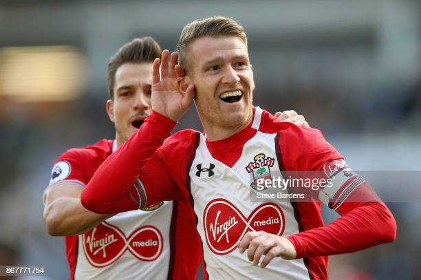 Steven Davis of Southampton celebrates as he scores their first goal with Cedric Soares of Southampton during the Premier League match between...