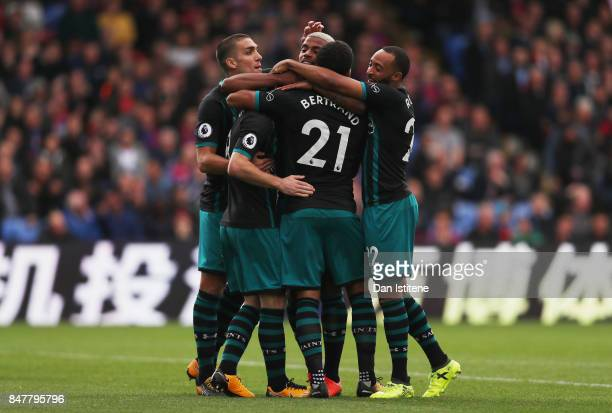 Steven Davis of Southampton celebrates scoring his sides first goal with his Southampton team mates during the Premier League match between Crystal...