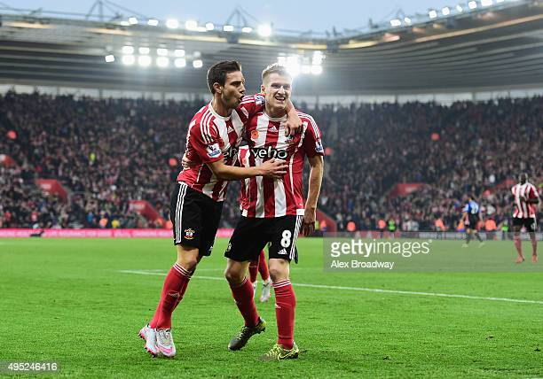 Steven Davis of Southampton celebrates with Cedric Soares as he scores their first goal during the Barclays Premier League match between Southampton...