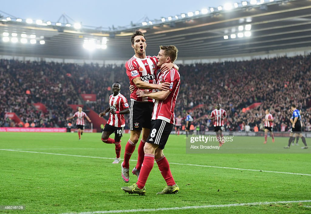 Steven Davis of Southampton celebrates with Cedric Soares of Southampton as he scores their first goal during the Barclays Premier League match...