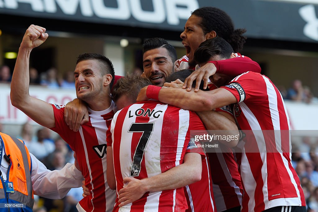 Steven Davis of Southampton celebrates with team mates after scoring his second goal during the Barclays Premier League match between Tottenham...