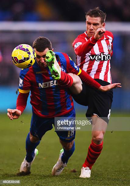 Steven Davis of Southampton challenges James McArthur of Crystal Palace during the Barclays Premier League match between Crystal Palace and...