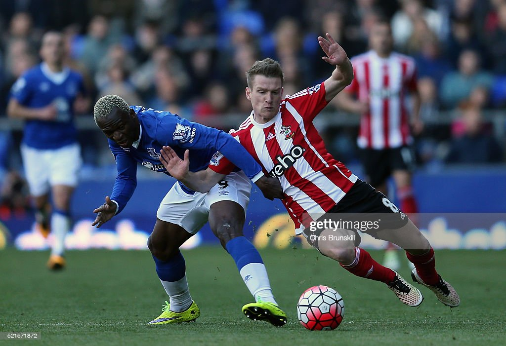 Steven Davis of Southampton chases Arouna Kone of Everton during the Barclays Premier League match between Everton and Southampton at Goodison Park on April 16, 2016 in Liverpool, England.
