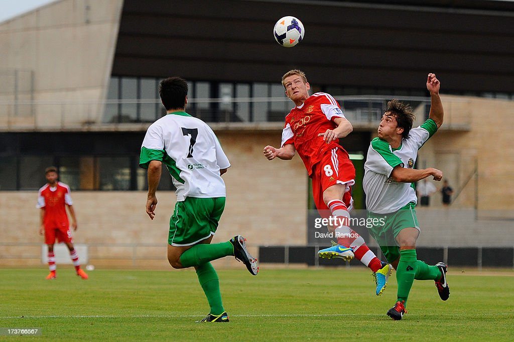 Steven Davis of Southampton duels for the ball with UE Llagostera players during a friendly match between Southampton FC and UE Llagostera at the Josep Pla i Arbones Stadium on July 17, 2013 in Girona, Spain.