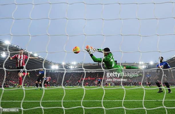 Steven Davis of Southampton shoots past goalkeper Adam Federici of Bournemouth to score their first goal during the Barclays Premier League match...