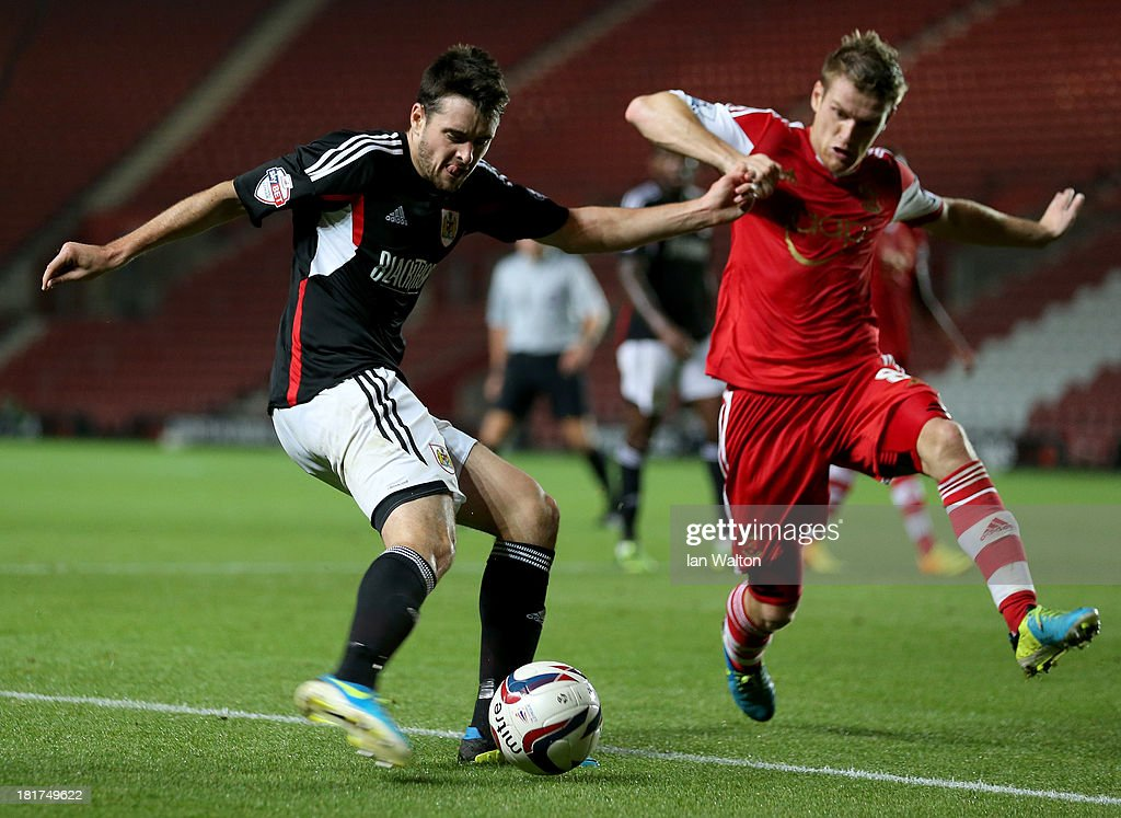Steven Davis of Southampton tries to tackle Brendan Maloney of Bristol City during the Capital One Cup Third Round match between Southampton and Bristol City at St Mary's Stadium on September 24, 2013 in Southampton, England.