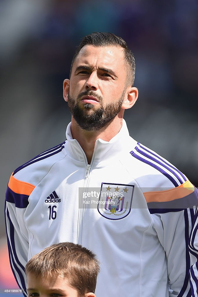 <a gi-track='captionPersonalityLinkClicked' href=/galleries/search?phrase=Steven+Defour&family=editorial&specificpeople=5733692 ng-click='$event.stopPropagation()'>Steven Defour</a> of Anderlecht looks on prior to the Belgiun Jupilar League match between RSC Anderlecht and Waasland-Beveren at Constant Vanden Stock Stadium on August 24, 2014 in Brussels, Belgium.