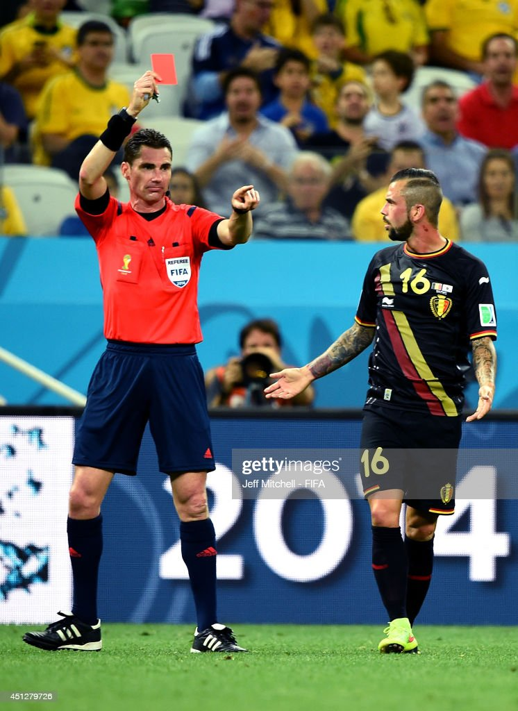 <a gi-track='captionPersonalityLinkClicked' href=/galleries/search?phrase=Steven+Defour&family=editorial&specificpeople=5733692 ng-click='$event.stopPropagation()'>Steven Defour</a> of Belgium is shown a red card by referee benjamin Williams during the 2014 FIFA World Cup Brazil Group H match between Korea Republic and Belgium at Arena de Sao Paulo on June 26, 2014 in Sao Paulo, Brazil.