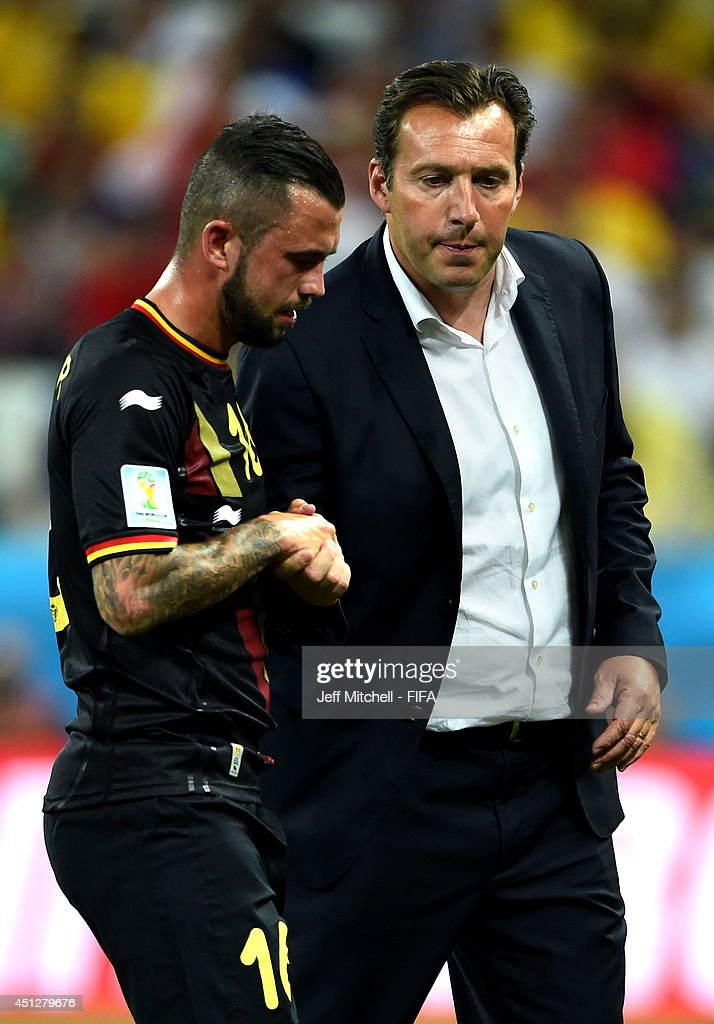 <a gi-track='captionPersonalityLinkClicked' href=/galleries/search?phrase=Steven+Defour&family=editorial&specificpeople=5733692 ng-click='$event.stopPropagation()'>Steven Defour</a> of Belgium of Belgium shakes hands with head coach <a gi-track='captionPersonalityLinkClicked' href=/galleries/search?phrase=Marc+Wilmots&family=editorial&specificpeople=1016207 ng-click='$event.stopPropagation()'>Marc Wilmots</a> as he walks off the pitch as he receives a red card during the 2014 FIFA World Cup Brazil Group H match between Korea Republic and Belgium at Arena de Sao Paulo on June 26, 2014 in Sao Paulo, Brazil.