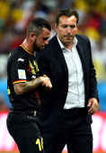 Steven Defour of Belgium of Belgium shakes hands with head coach Marc Wilmots as he walks off the pitch as he receives a red card during the 2014...