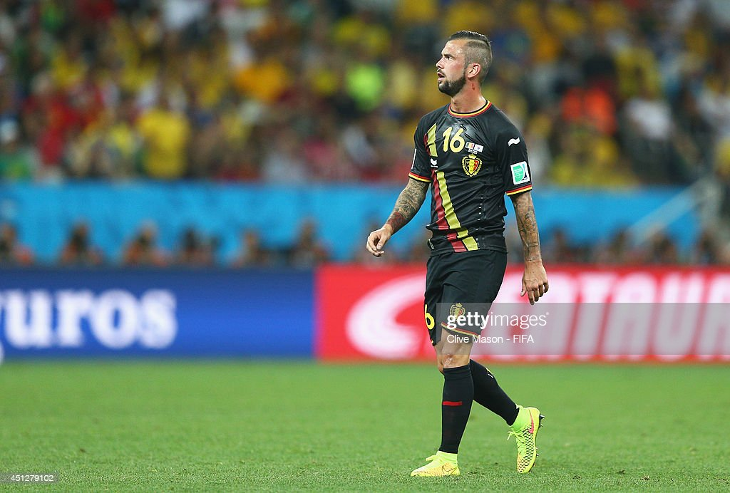 <a gi-track='captionPersonalityLinkClicked' href=/galleries/search?phrase=Steven+Defour&family=editorial&specificpeople=5733692 ng-click='$event.stopPropagation()'>Steven Defour</a> of Belgium walks off the pitch as he receives a red card during the 2014 FIFA World Cup Brazil Group H match between Korea Republic and Belgium at Arena de Sao Paulo on June 26, 2014 in Sao Paulo, Brazil.