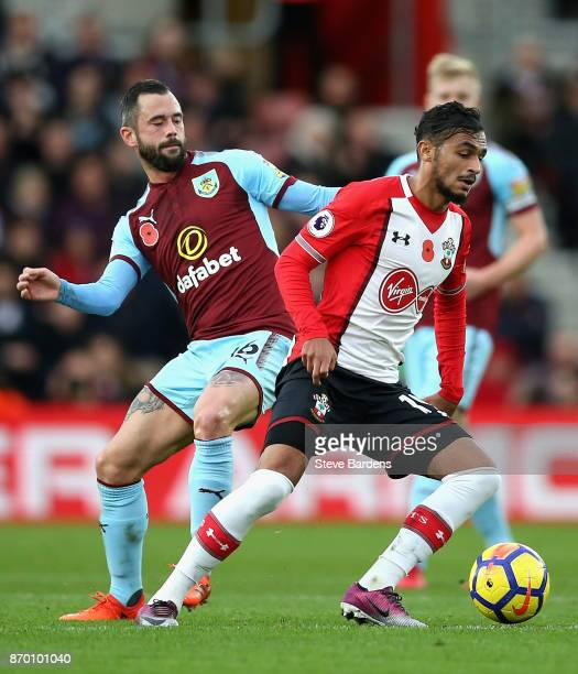Steven Defour of Burnley and Sofiane Boufal of Southampton battle for possession during the Premier League match between Southampton and Burnley at...