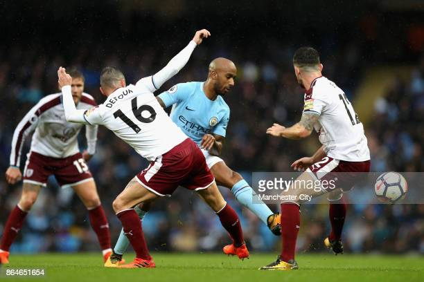 Steven Defour of Burnley tackles Fabian Delph of Manchester City during the Premier League match between Manchester City and Burnley at Etihad...