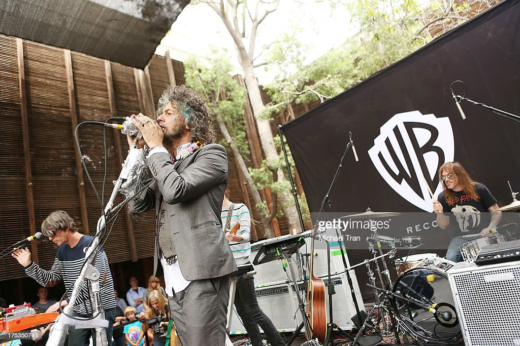 Steven Drozd, Wayne Coyne, Derek Brown and Kliph Scurlock of The Flaming Lips perform at the Warner Bros Records 3rd Annual 'Summer Sessions' - Flaming Lips held on August 2, 2013 in Burbank, California.