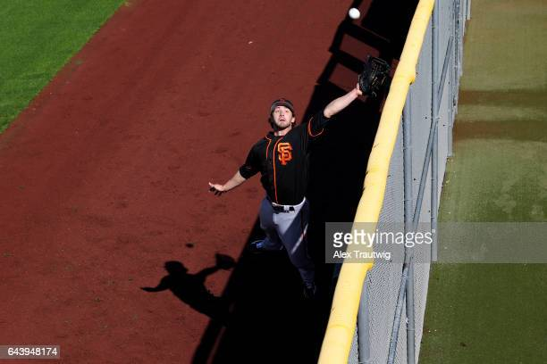 Steven Duggar of the San Francisco Giants practices catching near the wall during a workout on Monday February 20 2017 at Scottsdale Stadium in...