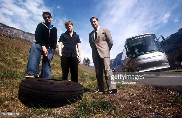 Steven Eagles Nicholas Millard and Jack Dunkley of Crackout pictured in the Swiss Alps after a tyre fell off their tour bus United Kingdom 2002