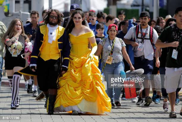 Steven Ellison and Diana Dehaini play the characters The Beauty and The Beast during Comic2017 in San Diego California on July 20 2017 / AFP PHOTO /...