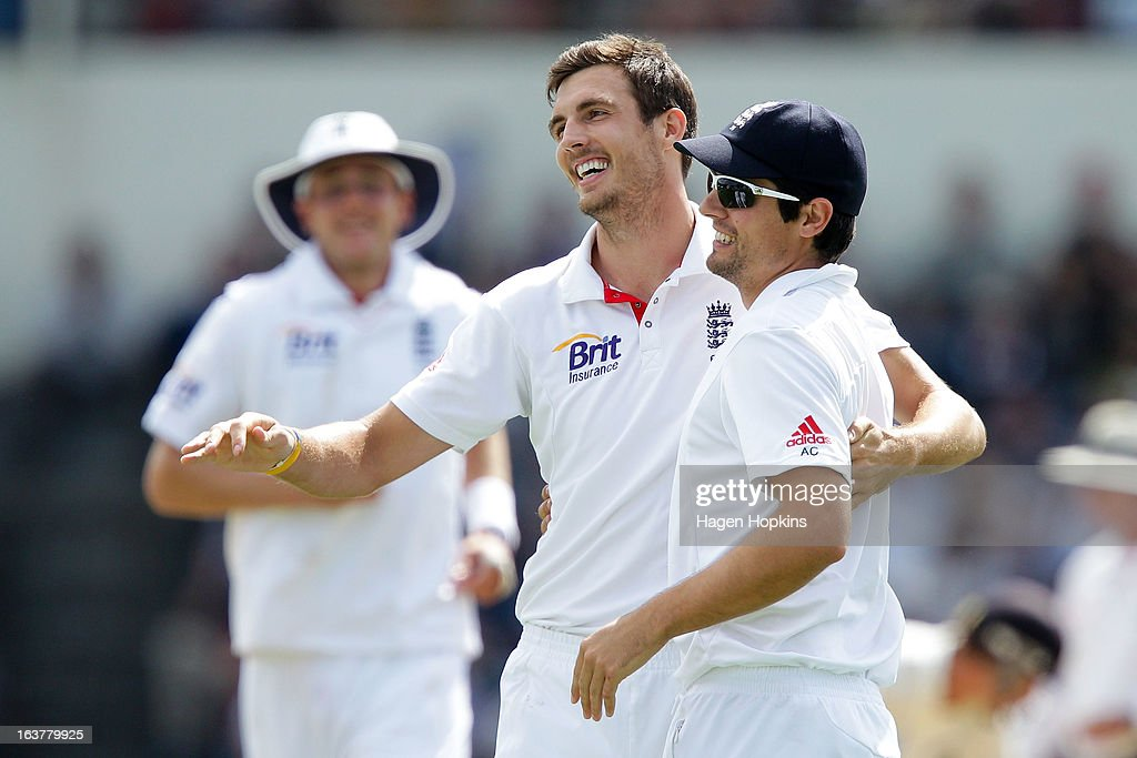Steven Finn (L) and <a gi-track='captionPersonalityLinkClicked' href=/galleries/search?phrase=Alastair+Cook+-+Cricket+Player&family=editorial&specificpeople=571475 ng-click='$event.stopPropagation()'>Alastair Cook</a> of England celebrate the wicket of Brendon McCullum of New Zealand during day three of the second Test match between New Zealand and England at Basin Reserve on March 16, 2013 in Wellington, New Zealand.
