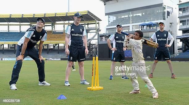 Steven Finn Ben Stokes Ian Bell and Alex Hales of England coach local children during a charity event at R Premadasa Stadium on December 6 2014 in...